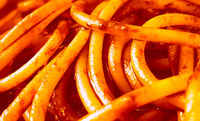 close-up view of cooked spaghetti with tomato sauce