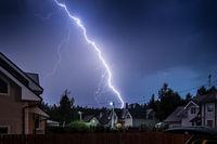Lightning in the sky outside the city. Lightning during thunderstorm.
