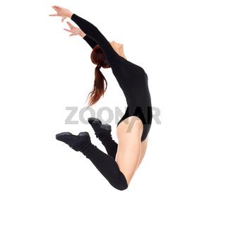 Beautiful moden female dancer jumping