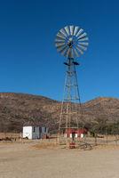 Windmill on a farm in the Erongo Mountains, Namibia