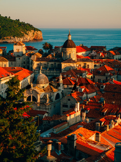 Dubrovnik Old Town, Croatia. Tiled roofs of houses. Church in th