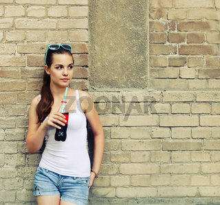 Beautiful young girl with drink