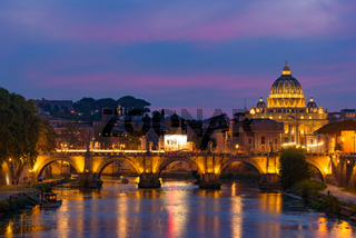 Sunset view of St. Peter's Basilica, Ponte Sant'Angelo, and Tiber River in Rome, Italy