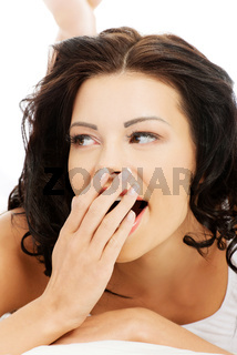 Face closeup of a beautiful young and fit woman yawning