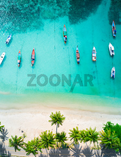 Aerial view of tropical beach and longtail boats