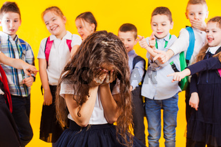 School girl being bullied by classmates. School bullying concept