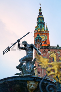 Gdansk, Poland. Statue of Neptune in a fountain, symbol of the city. Town Hall on background.