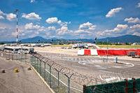 Bergamo Orio Al Serio airport airplanes and town of Bergamo view.