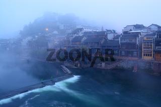 Foggy river landscape