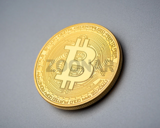 Bitcoin coin on brushed aluminium background