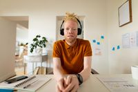 Albino african american man working from home making video call
