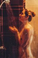 Beatiful woman taking a shower.