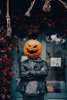 Guy with a pumpkin head poses for the camera
