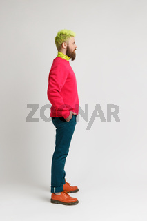 Hipster emotional man with green head on gray background.