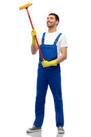 male cleaner in overall with window cleaning mop