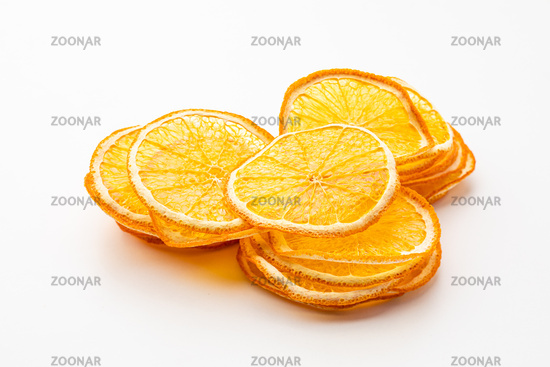 Orange dried fruits heap close up isolated