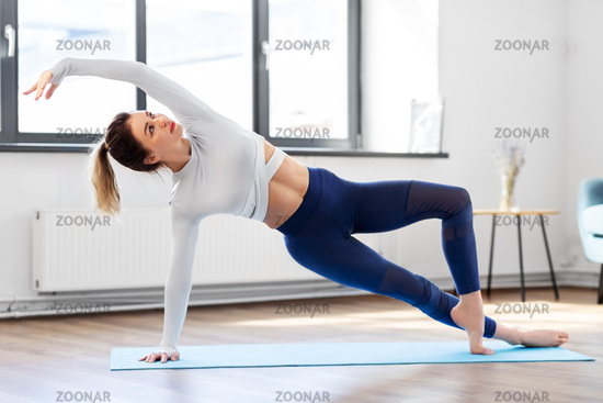 young woman doing yoga at studio