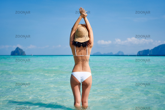 beautiful happy girl enjoy her tropical beach vacation