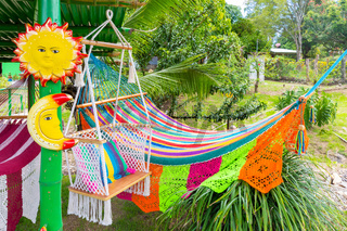 Panama Hacia town, multicolored embroidered hammock and rocking chair