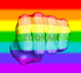 Fist of a man punching, rainbow flag pattern