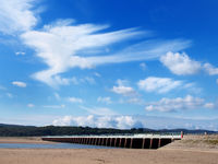 view of the beach at arnside with the leven railway viaduct and river in the south lakes area of cumbria