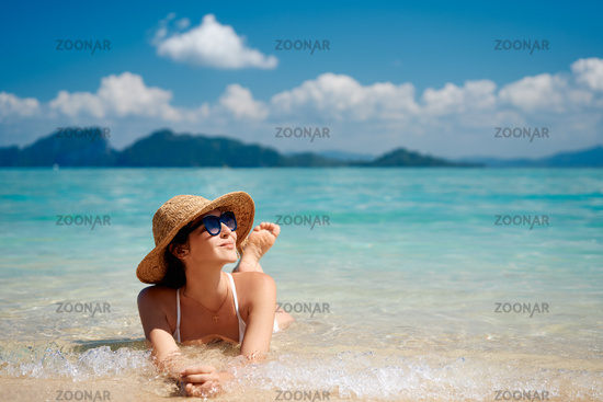 Portrait of a sensual young female in white bikini enjoying warm tropical ocean water with copy space.