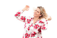 Happy mature woman dance on white background