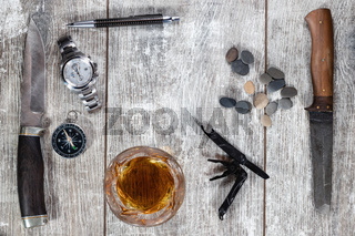 Men's items and accessories lie on a light wooden background