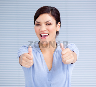 Successful businesswoman with thumbs up