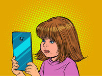 Little girl and smartphone. Internet communication, gadgets and technologies