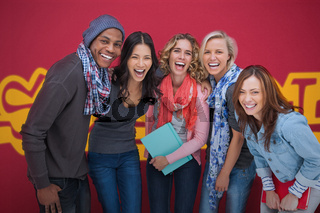 Group of cheerful friends laughing together