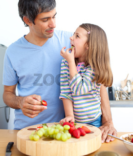 Attractive father and his daughter having breakfast