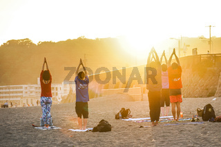Twilight of sandy beach and yoga