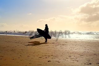 silhouette of kitesurfer on sand beach