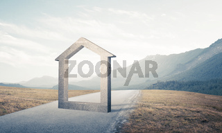 Conceptual background image of concrete home sign on asphalt road