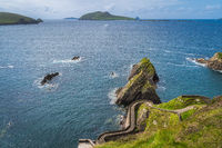 Dunquin Pier and harbour with tall cliffs, turquoise water and islands, Dingle, Wild Atlantic Way