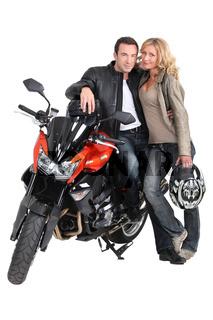 Biker couple and bike.