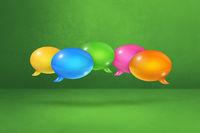 multicolor speech bubbles on green background