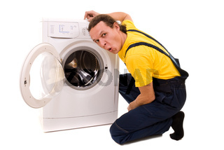 Repairman and washing machine isolated on white background