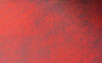 A dynamically glowing red background with stripes running through it