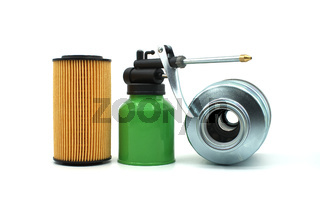 Vehicle engine oil filters and hand pump oiler