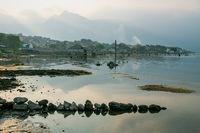Coast along lake Atitlan during sunset in San Pedro la Laguna, Guatemala
