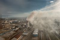 Oil and gas refinery plant in smoke