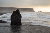 Rock formation at Dyrholaey at sunset, Iceland