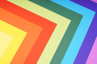 rainbow colored paper background with angular pattern