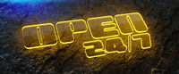 glowing open sign on wet rock