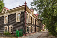 Old wooden residential buildings in the central part of Tomsk