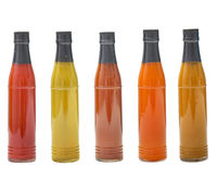 Set of glass bottles with  delicious sauces on white background