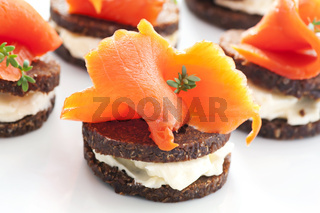 Tapas with wild salmon on the bread slices