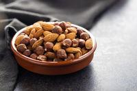 Peeled hazelnuts and almonds. Sweet nuts.